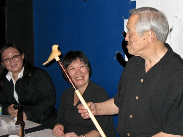 "photo of Jo Takehara Sensei receiving the ""hato no tsue."""