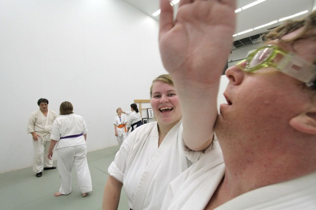 Andrea of Aikido of West Bend hits David Babbitt on the chin.