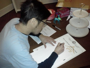 Ivan Lee signs certificates for the Chicago Aikido Club